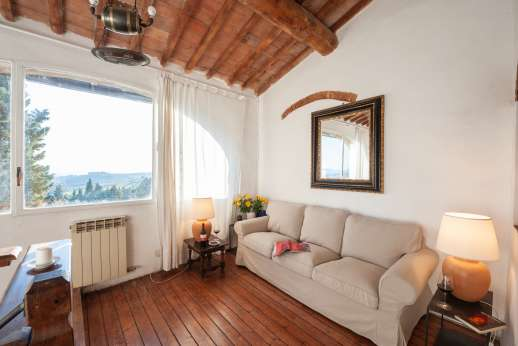 Tizzano - Top of the stairs relaxing seating area with stunning view