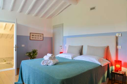 Villa Caprolo - Second floor, double bedroom with en suite bathroom, and geo thermal air conditioning.