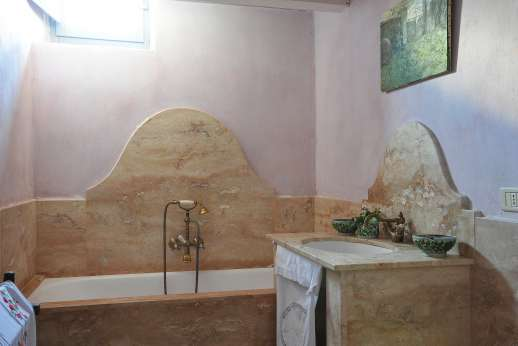 The Rose Barn - A marble bathroom with bath.