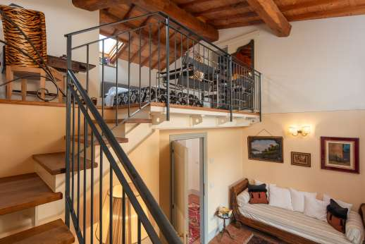 Podere Brogi - Air-conditioned double bedroom suite set on a mezzanine with a private balcony and an ensuite bathroom with shower.