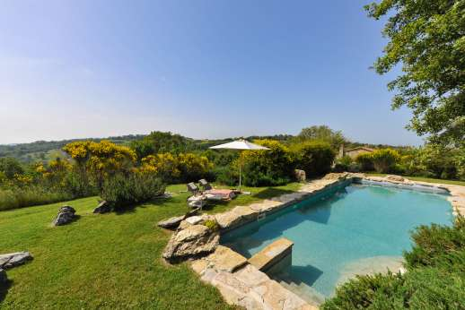 Casetta Termine - A lovely informal garden bordered by fields. The swimming pool, 6 x 10m/19 x 32 feet